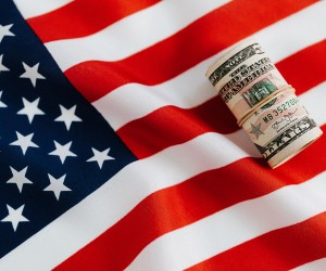 American flag with money on top of it