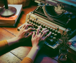 Photo of a person at a typewriter