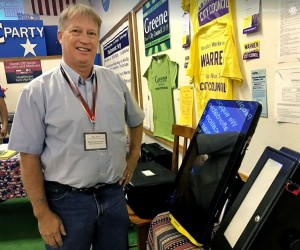 Rich Corfman Poses By New Voting Machine