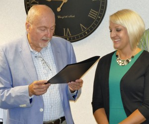 Commissioner Ron Amstutz read proclamation to Director Brynn Jackson